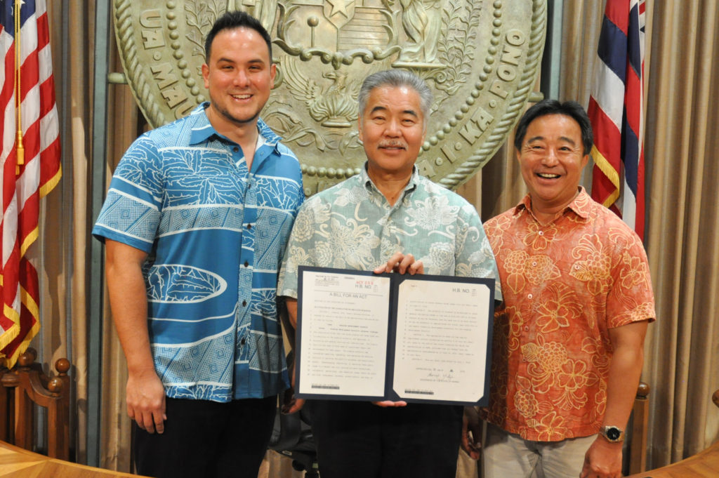 Representative Aaron Ling Johanson, Governor David Ige and Senator Glenn Wakai at the signing of bill HB 1586 on July 8, 2019.