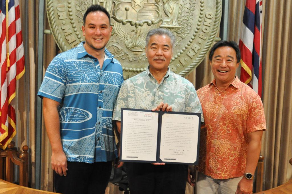 Representative Aaron Ling Johanson, Governor David Ige and Senator Glenn Wakai at the signing of bill HB 1586 on July 8, 2019.